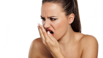 a woman is shocked by her bad breath