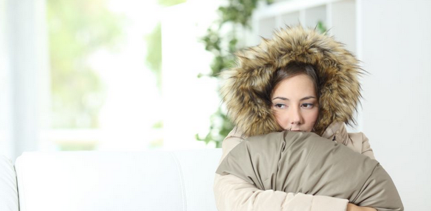 image of a woman feeling cold